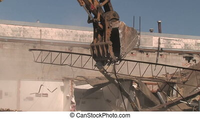 Crane Moving Rubble 2 - A crane moves rubble around at a...