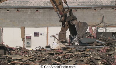 Crane Moving Rubble 3 - A crane moves rubble around at a...