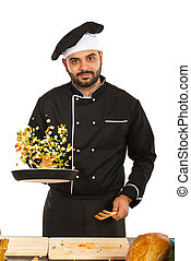 Happy chef tossing vegetables - Happy chef man in black...