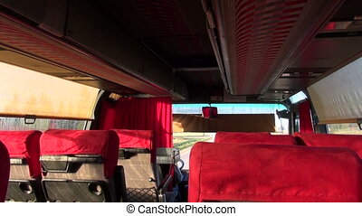 empty bus interior with seats on road