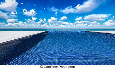 Infinite swimming pool with ocean in background