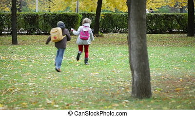 Playful run - Joyful siblings having fun in the park