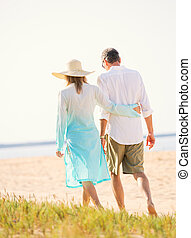 Middle Aged Couple Enjoying Walk on the Beach - Happy...