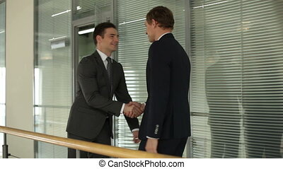 Meeting of businessmen - Two businessmen meeting and talking...