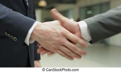 Business deal - Handshake of business partners