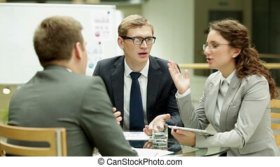Business meeting - Business team discussing their ideas at...
