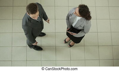Managers talking - Business partners talking while their...
