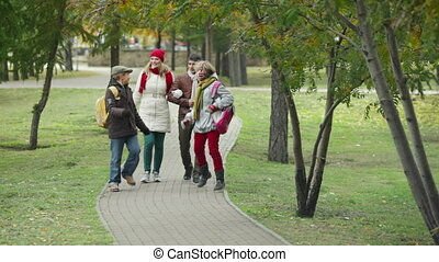 Family walking - Two kids and their parents walking together...