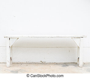 Bench - White bench on the white concrete wall