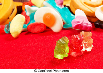 jelly bears on a red tablecloth