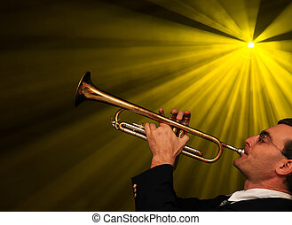 Trumpet Player - a man plays trumpet with stage lights...