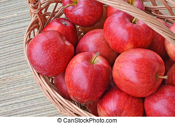 Red apples in a wicker basket - Ripe, red Gala apples in a...