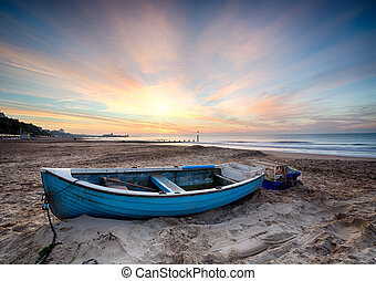Fishing Boat at Sunrise - Turquoise blue fishing boat at...