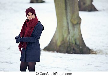 Cheerful Woman Playing in the Snow