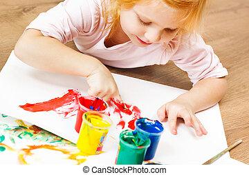 Cute little redhead girl painting. - Cute little redhead...