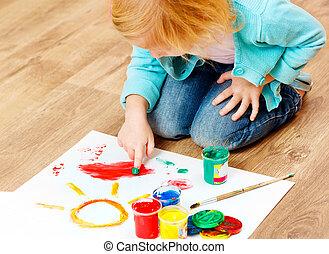 Cute little redhead girl painting - Cute little redhead girl...