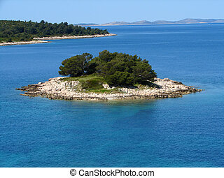 Small island Krbelica - Krbelica, small island on blue...