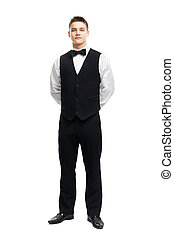 Full length portrait of young smiling waiter standing with...