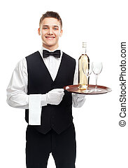 Young waiter with bottle of wine on tray
