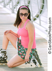 beautiful young girl in a miniskirt skater