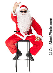 Santa Claus showing the middle finger sitting in a chair...