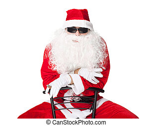 Santa Claus wearing sunglasses and smoking a cigar isolated...