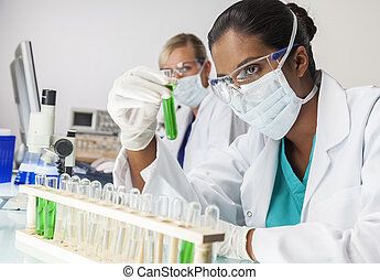 Asian Indian Female Laboratory Scientist Green Test Tube -...