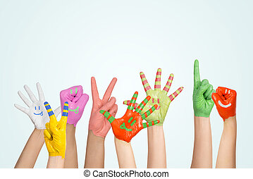 painted children's hands in different colors with smilies