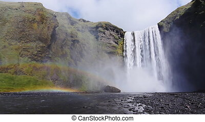 waterfall skogafoss - big Skogafoss waterfall crossed by...