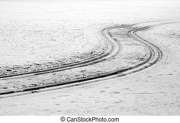 curved tracks in snow - winter scene with curved tracks in...