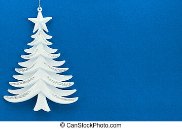 Christmas tree on a background of blue velvet paper