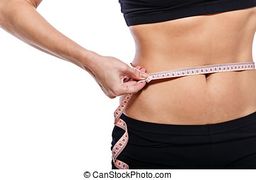 Weight loss - Girl measuring waist circumference after a...