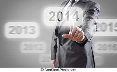 2014 on touch screen - Businessman selects 2014 on touch...