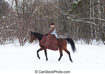 Woman in the brown riding habit keeps the Arab racer