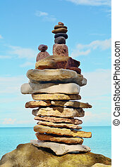Steadfast - Stack of pebbles on the sea boulder