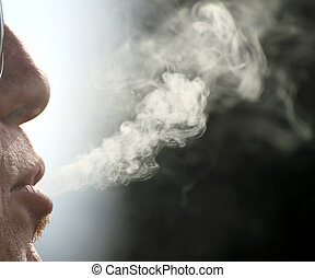 moker - backlit cigarette smoke and smoker in a moment of...