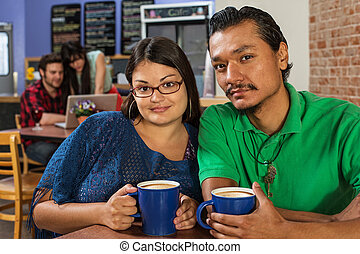 Handsome Latino Couple - Grinning Latino and Asian couple in...
