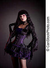 Romantic gothic girl in purple and black gothic Halloween...