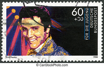 GERMANY - CIRCA 1988: A stamp printed in Germany shows Elvis...