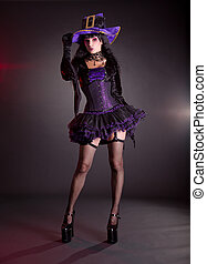 Sexy witch in purple Halloween costume - Sexy witch in...