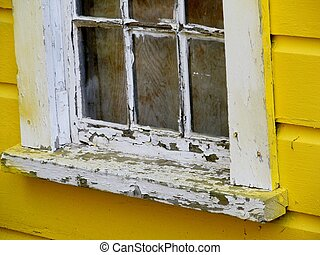 weathered and worn - window sill with chipped paint on...