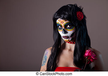 Halloween sugar skull girl with red rose