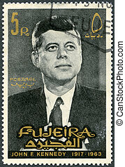 FUJEIRA - 1965: shows Portrait of John F Kennedy 1917-1963 -...