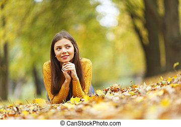 Girl laying on autumn leafs - Girl laying on leafs in the...
