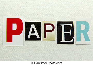 paper word cut from newspaper on handmade paper background