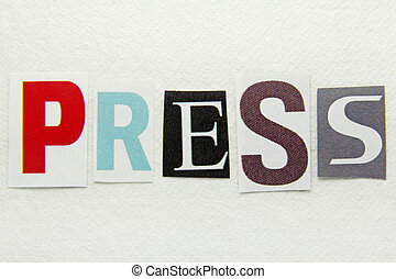 word press cut from newspaper on handmade paper background