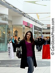 Shopping spree at the mall - A young woman shopping at the...