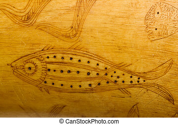 folk art fish carving on 1800s powder horn detail
