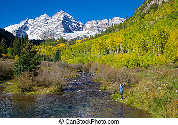 Wonder and Awe of Maroon Bells - a girl with arms raised in...