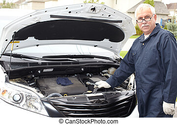 Car mechanic. - Car mechanic in uniform. Auto repair...